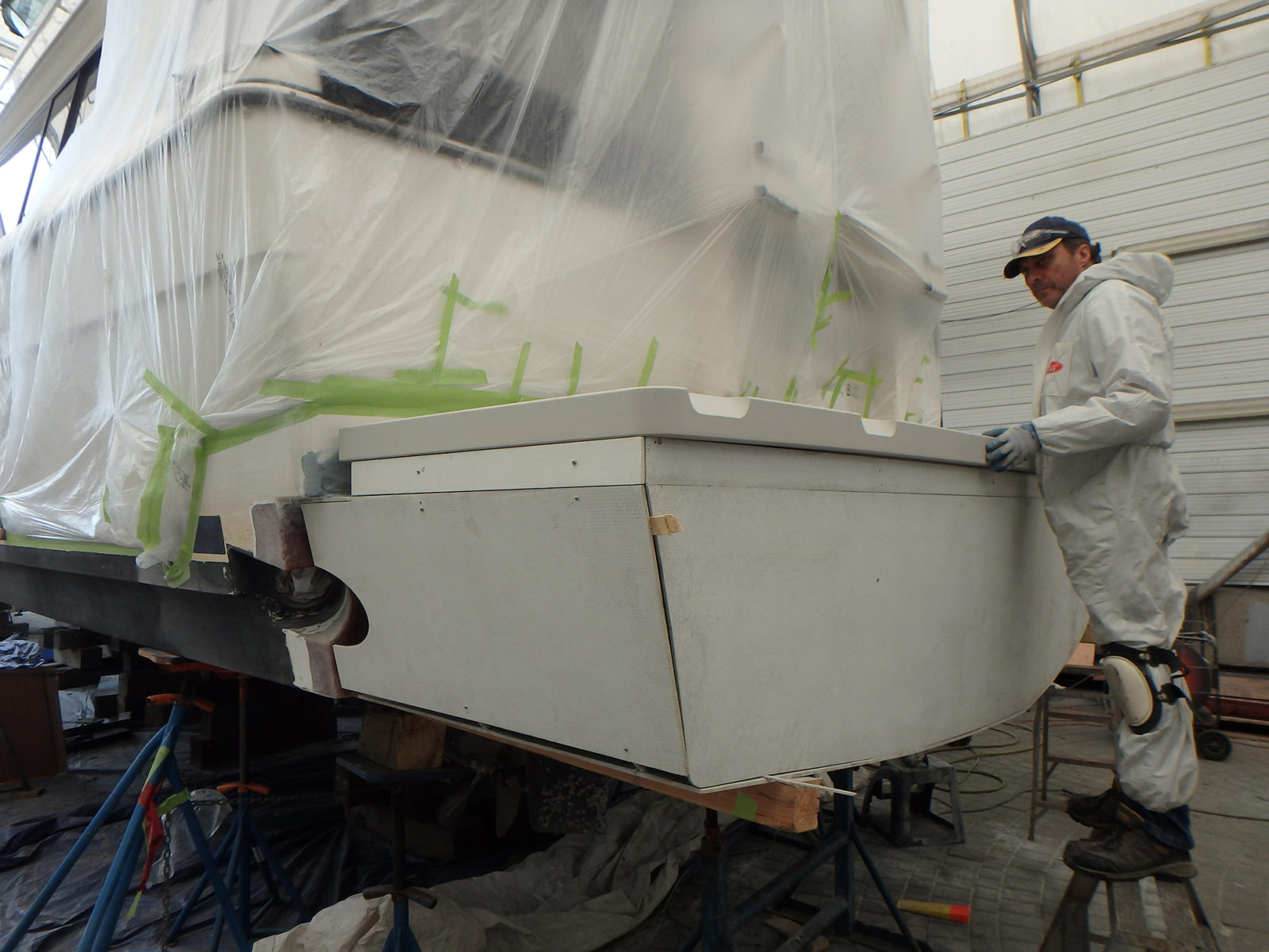 Deon, one of our fiberglassers, getting ready to finish the job